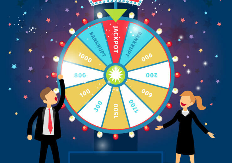 Business people with financial wheel of fortune. Gambling concept